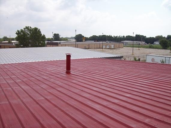 Commercial roofing job with red roof.