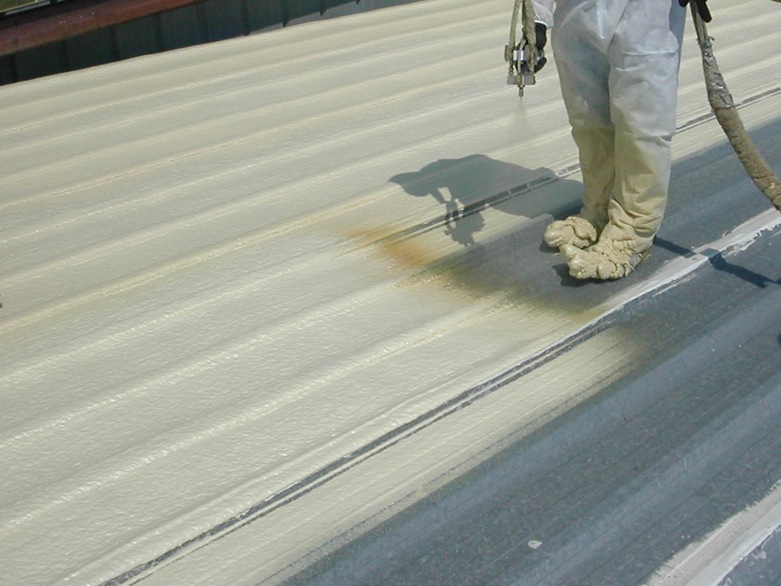 4 Spray Polyurethane Foam roofing helps to insulate this cold metal roof with a minimum coating of one and half inches.